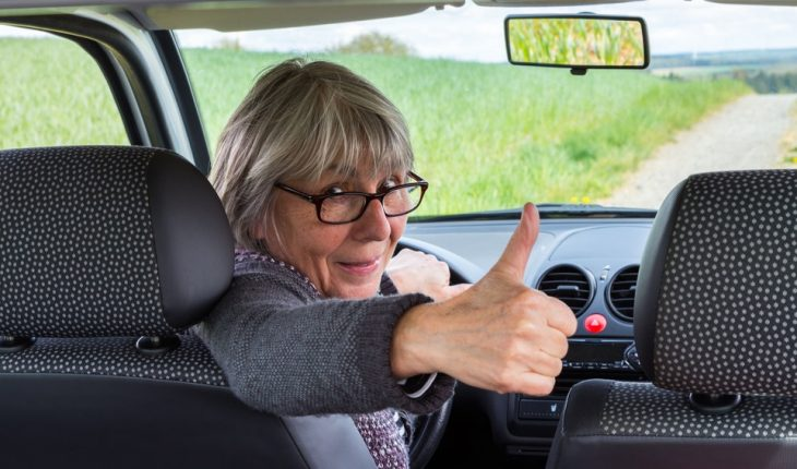 older woman, car, thumbs up