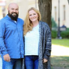 overweight couple standing by trees