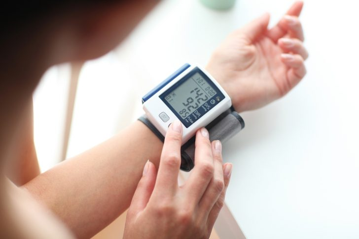 patient-with-lood-pressure-wrist-monitor