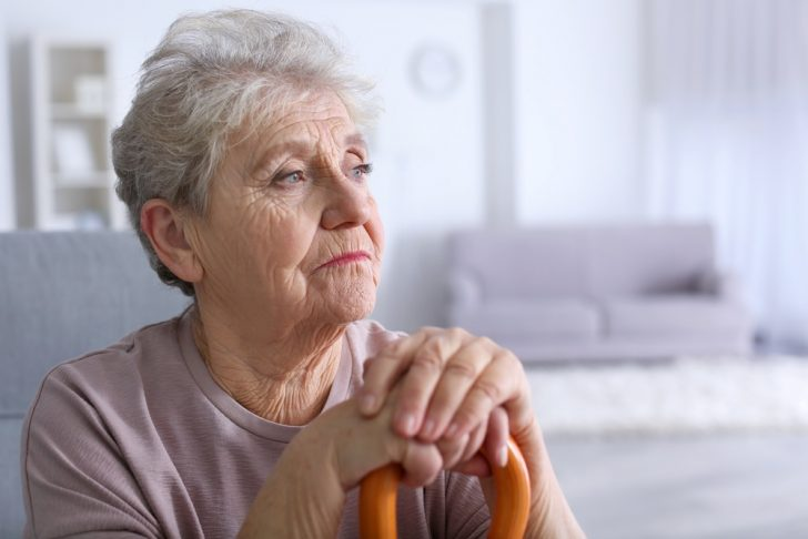 sad-older-woman-with-cane