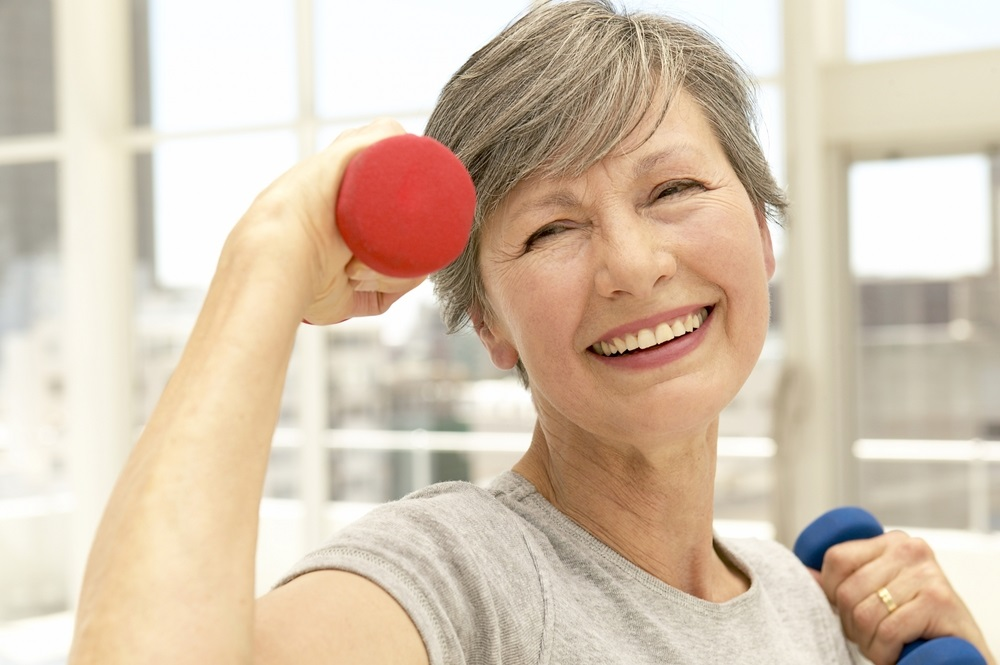 senior-woman-with-hand-weights