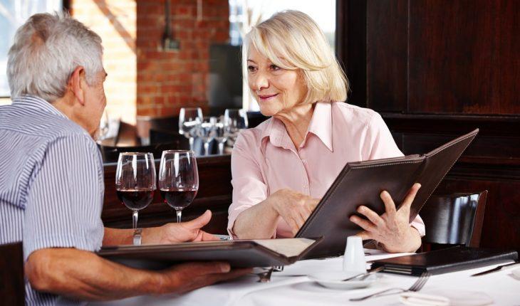 senior-couple-reading-menu-in-restaurant
