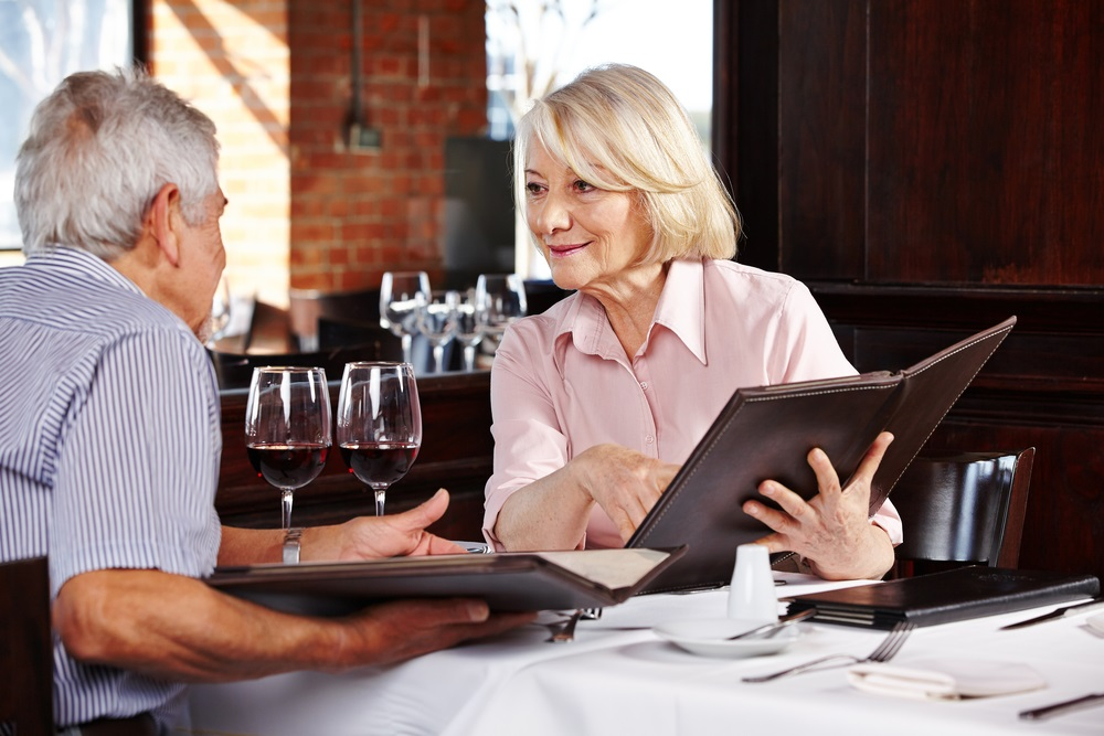 senior-couple-reading-menu-in-restaurant