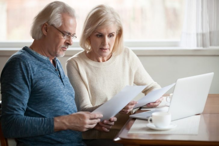 senior-couple-worried-about-finances on laptop