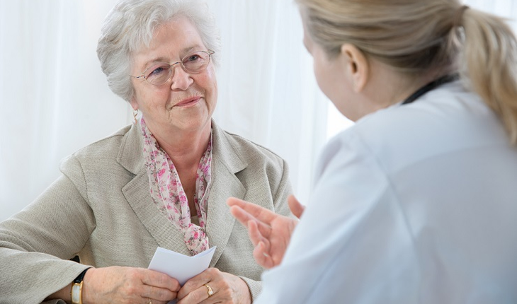 Senior woman asking doctor questions