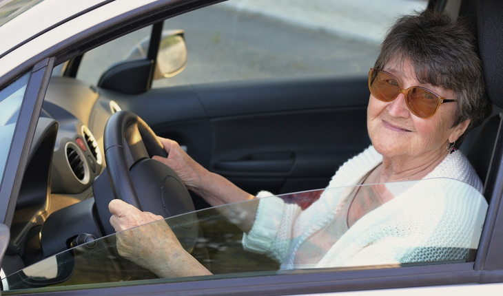 Senior woman at wheel of car