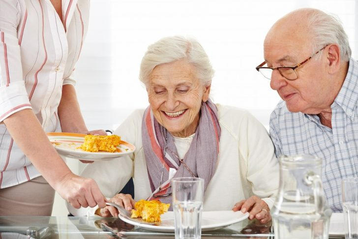 Seniors eating in assisted-living home