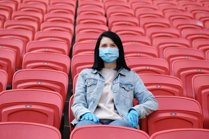 A,Female,Fan,In,A,Medical,Mask,And,Rubber,Gloves