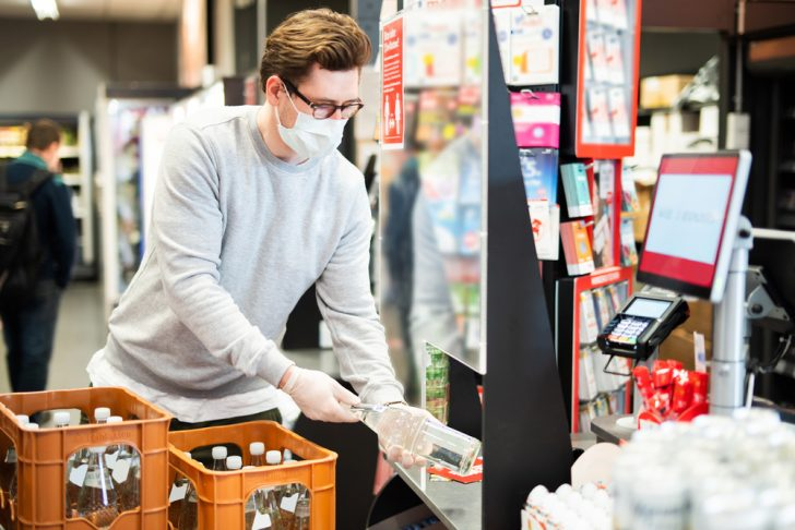supermarket-cashier-with-food-and-facial-mask