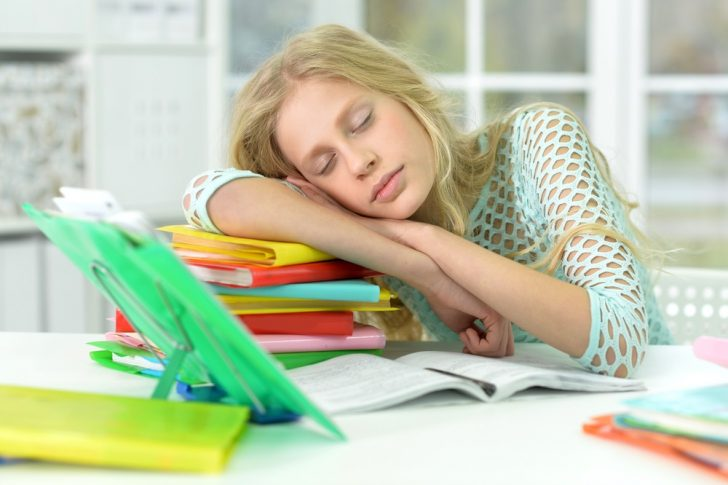 teenage-girl-sleeping-in-school