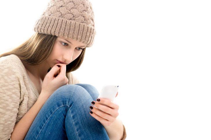 teenage-looking-at-smartphone