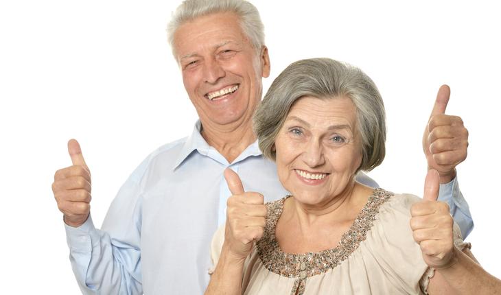 Thumbs up senior couple