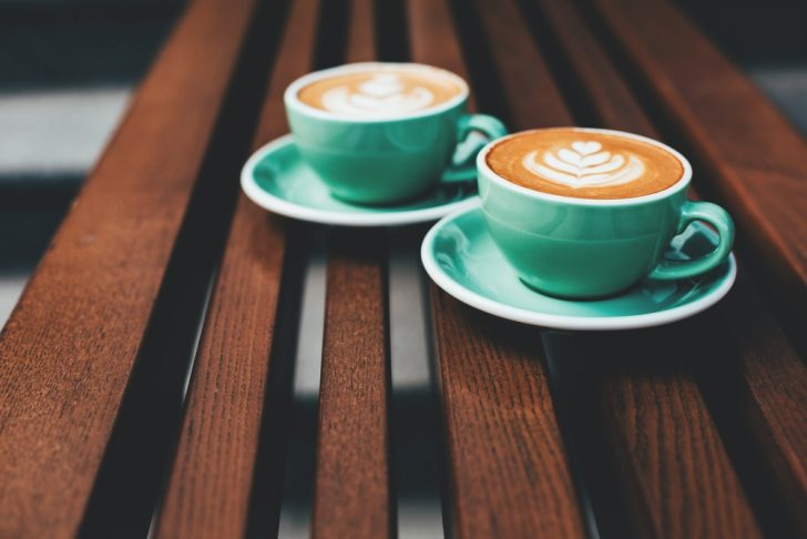 two lattes in gree cups