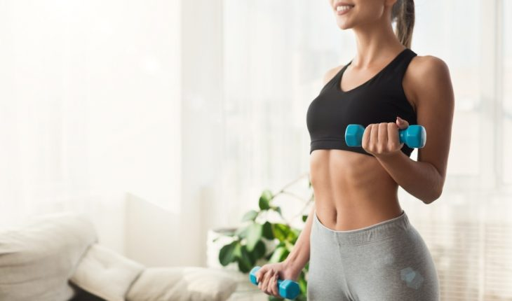 woman exercising in hotel strength training