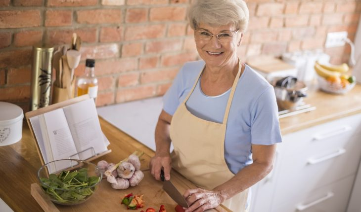 woman cooking healthy in kitchen