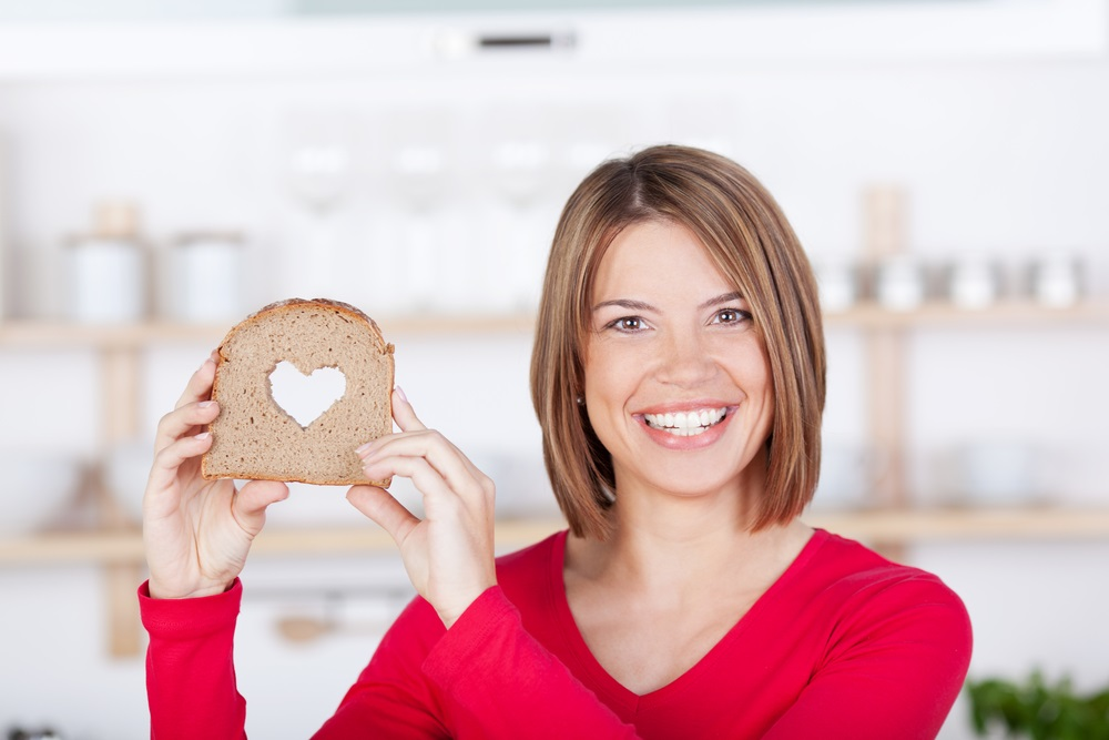 woman-holding-slice-of-bread