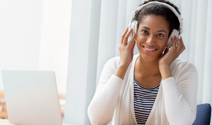 woman-listening-to-music-on-a-computer