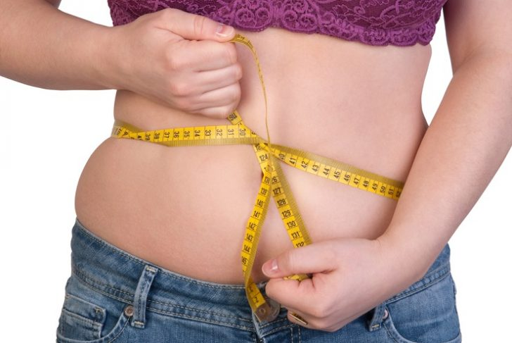 woman-measuring-belly-fat