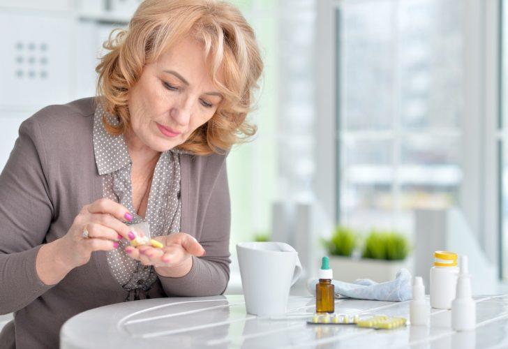 woman-taking-pills