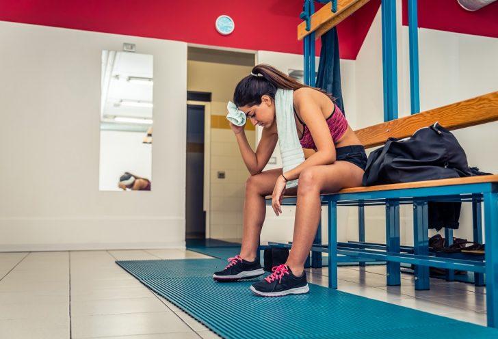woman wearing proper footwear in gym