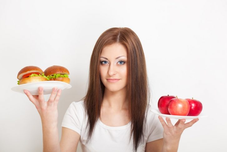 woman-with-junk-food-and-fruit