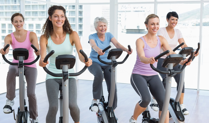 Women bicycling in gym