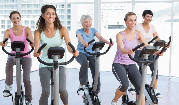 Women bicycling in gym