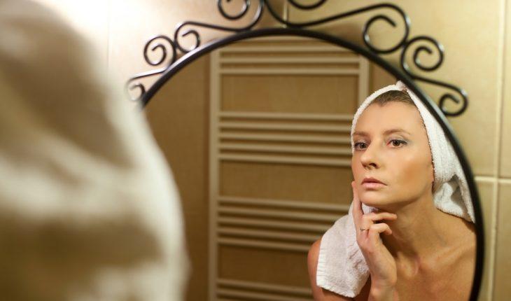 women-looking-in-bathroom-mirror
