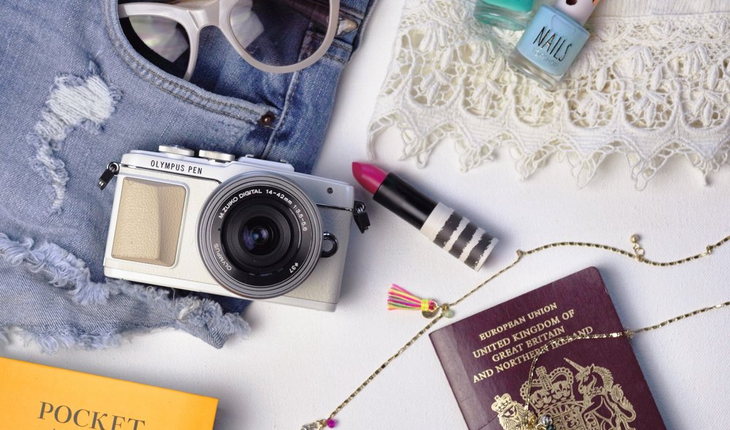travel items - passport,camera,nail polish,sunglasses