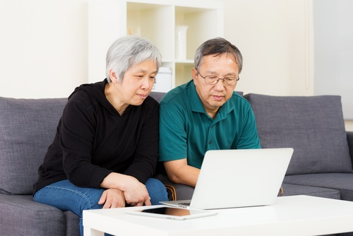 asian-couple-reading-computer