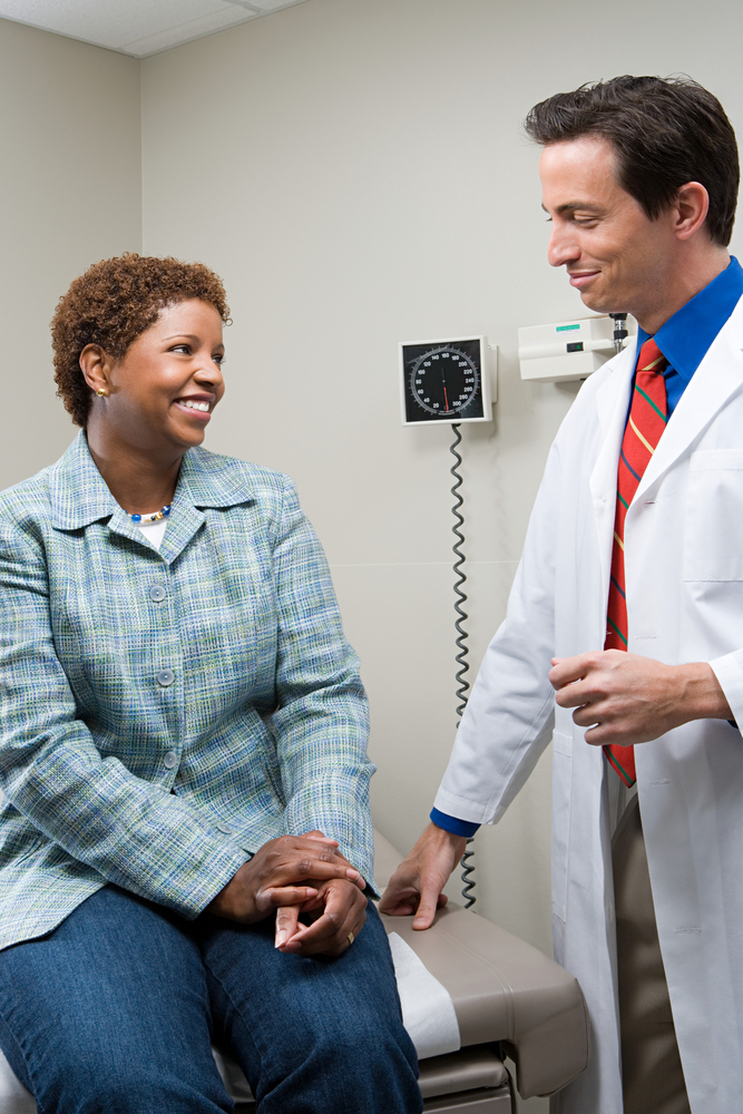 black woman with doctor