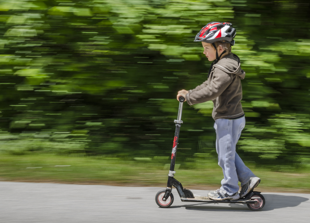 child on scooter with helmet.jpg