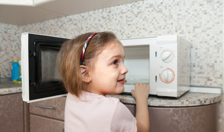Child using microwave