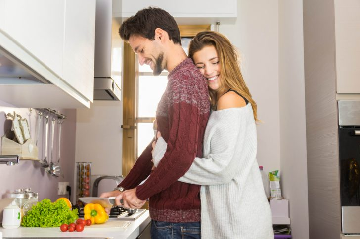 couple-cooking-and-hugging