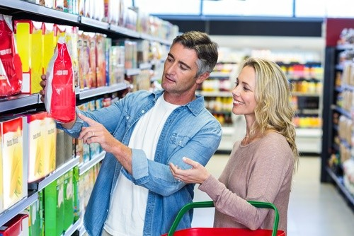couple looking at food in supermarket