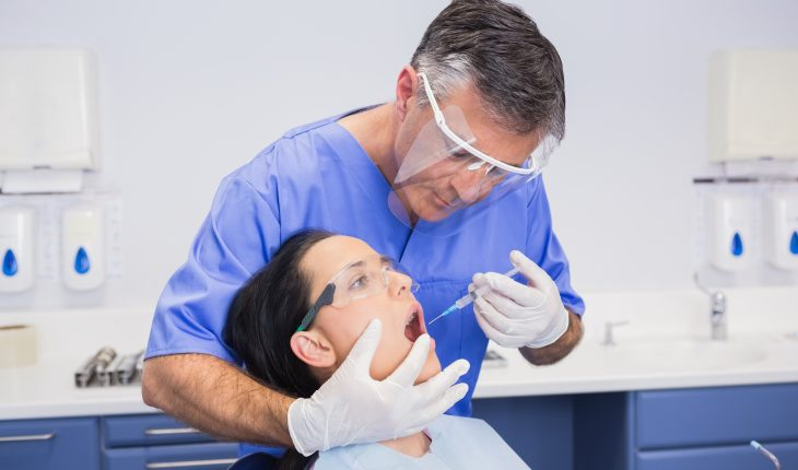 dentist wearing a face shield