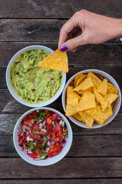 dipping guacamole