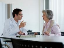 doctor consulting with mature woman patient.jpg