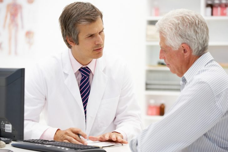 doctor and older patient