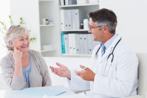 doctor talking with mature woman