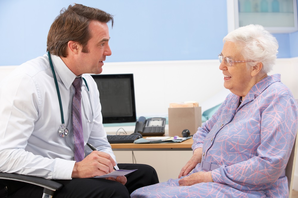 doctor talking with woman patient