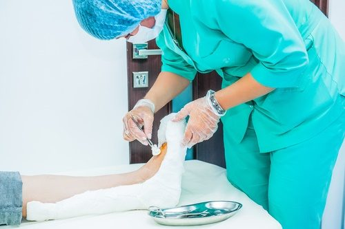 doctor-treating-wound