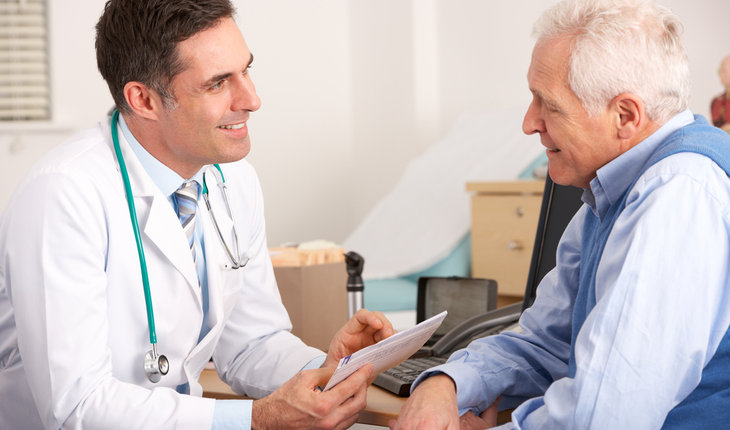doctor meeting with older male patient