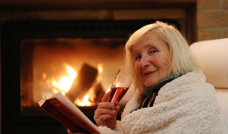 elderly woman drinking wine