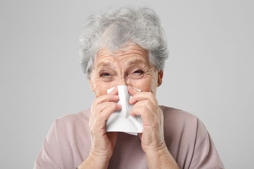 elderly woman with cold or flu