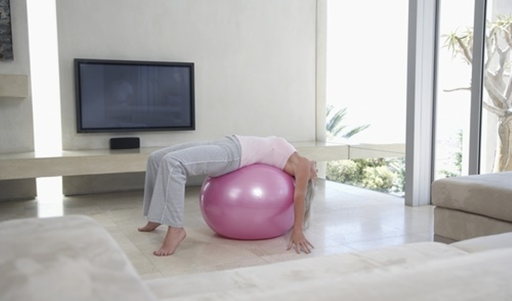 exercise on ball in front of tv