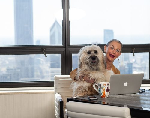 woman and her dog with laptop