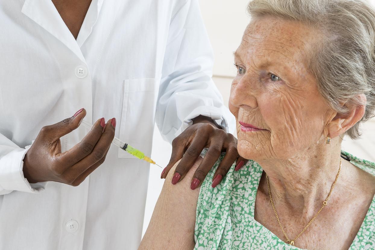 flu shot senior woman