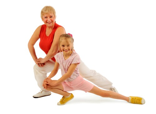 grandmother and granddaughter exercising