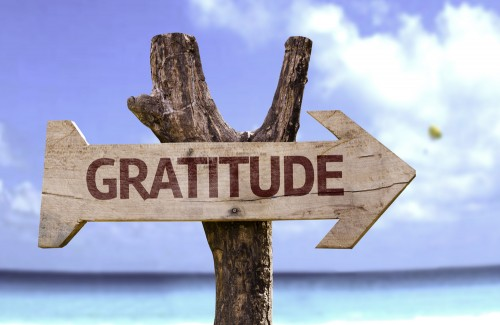 gratitude sign on beach